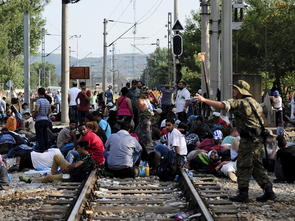 Macedonian special police guard the border as more than a thousand migrants wait at Macedonia's border with Greece. (Ognen Teofilovski/Reuters/Landov)