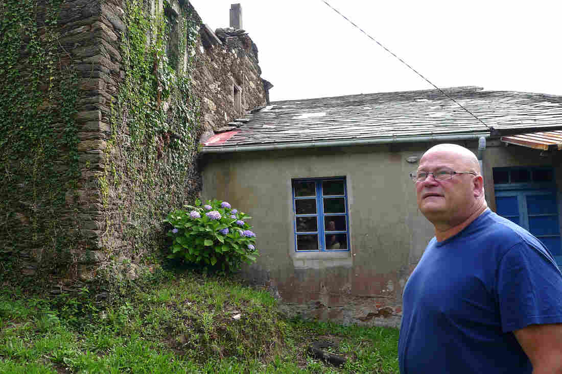 Mark Adkinson, a Briton who lives in Spain, runs a real estate agency selling abandoned villages and other historic properties. Here Adkinson stands amid buildings for sale in the abandoned village of O Penso.