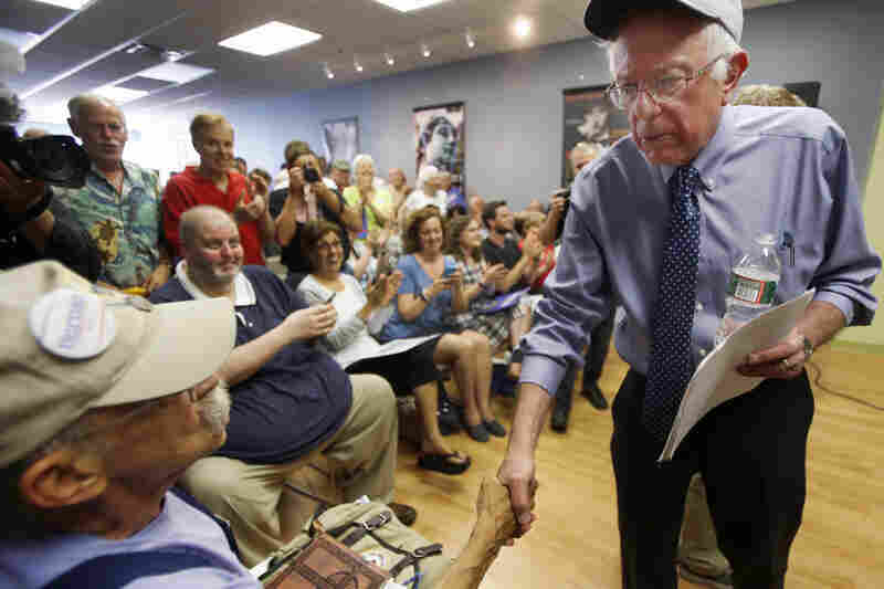 Democratic presidential candidate Sen. Bernie Sanders, I-Vt., reaches out to shake hands with Karl Bergeron of Northwood, N.H., on May 27, 2015, in Concord, N.H.