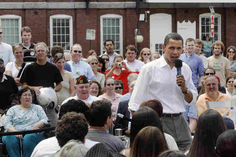 Then senator and presidential hopeful Barack Obama speaks during a campaign stop in a parking lot in the mill section of Manchester, N.H., July 20, 2007.