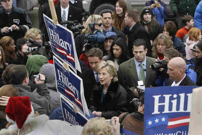 Democratic presidential hopeful, Sen. Hillary Rodham Clinton is swarmed as she greets people on the street following a campaign visit to the River House Cafe in Milford, N.H. on Dec. 22, 2007.