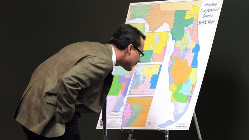Florida Republican state Sen. Rene Garcia looks at a map for proposed changes in congressional districts during a Senate committee meeting on reapportionment in 2012.