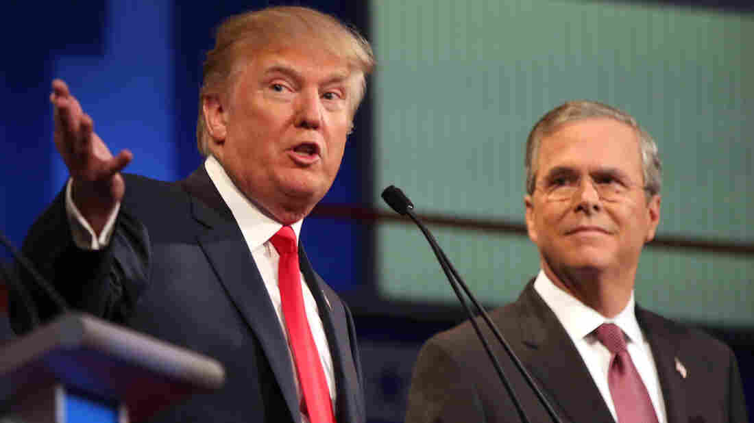 Republican presidential candidate Donald Trump speaks as Jeb Bush listens during the first Republican presidential debate in Cleveland.