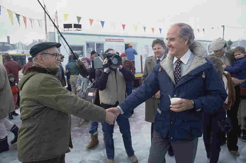 Former Sen. George McGovern, right, shakes hands with a man while participating in a fishing derby, Feb. 4, 1984, Meredith, N.H.