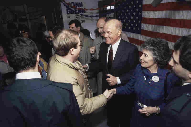 Sen. John Glenn, D-Ohio (center) and his wife, Annie Glenn (right) greet supporters at Glenn's campaign headquarters, Feb. 5, 1984, Keene, N.H.
