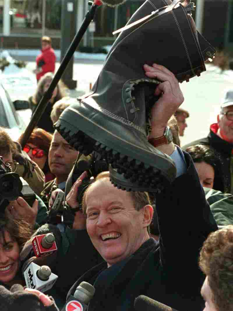 Republican presidential hopeful Gov. Lamar Alexander, holds up a pair of high top boots after a visit to a L.L. Bean store in Concord, N.H., February 7,1996.