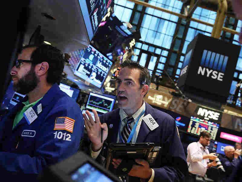 Traders work on the floor of the New York Stock Exchange on Friday. The Dow Jones industrial average dropped 531 points, or more than 3 percent.