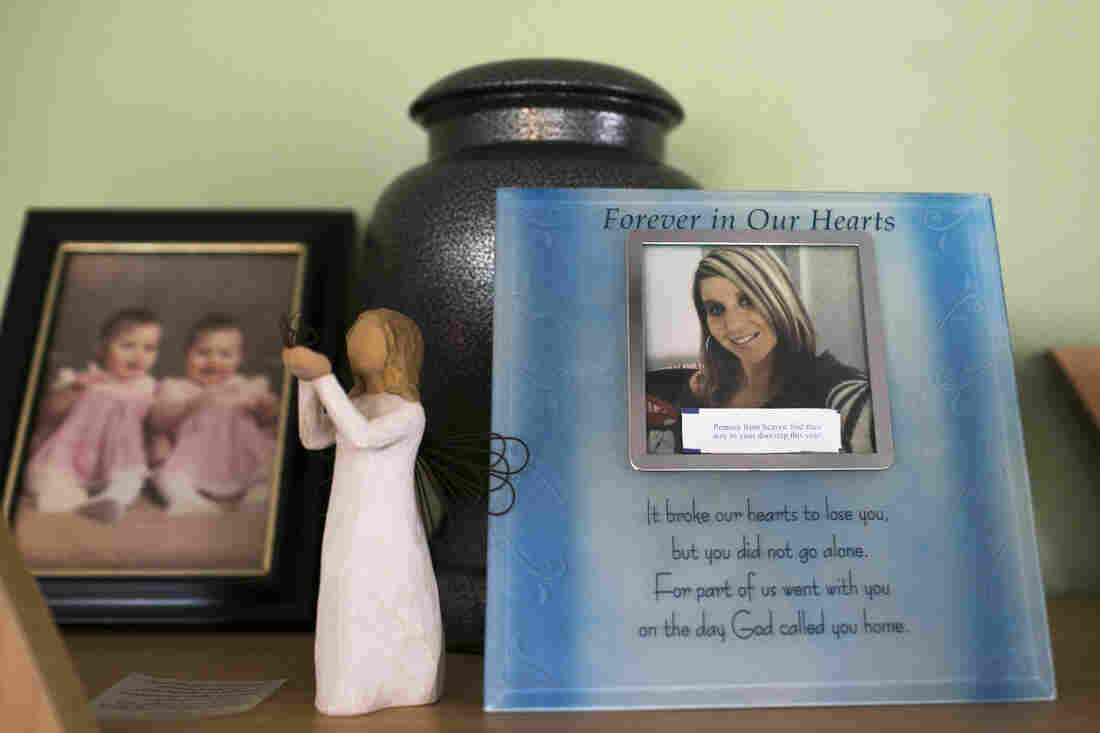 Photos and an urn of ashes to remember Chrystina Carey, Beth Carey's twin sister who died of a drug overdose in 2013, sit in her home in Marion.