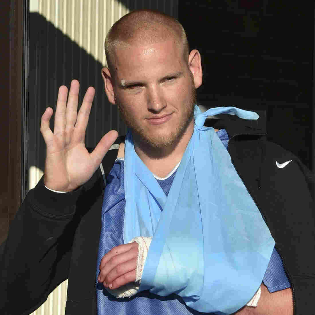 U.S. Air Force Airman First Class Spencer Stone waves as he departs the Clinique Lille Sud, which specializes in hand injuries, in Lesquin, France, on Saturday. He was one of several men who helped subdue the train assailant.