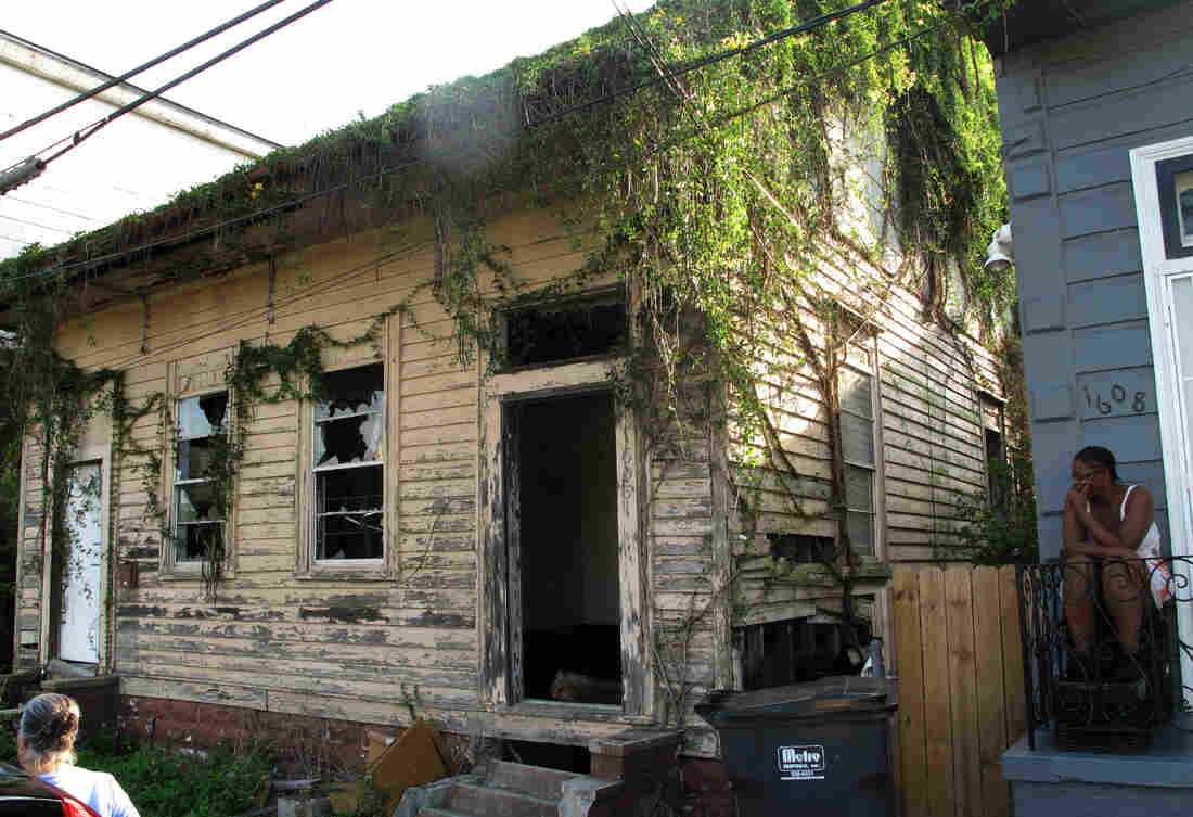 Despite the city's strategy of auctioning blighted properties, houses like this remain 10 years after Hurricane Katrina. Vandals have stripped the home's cypress floors and other architectural artifacts.