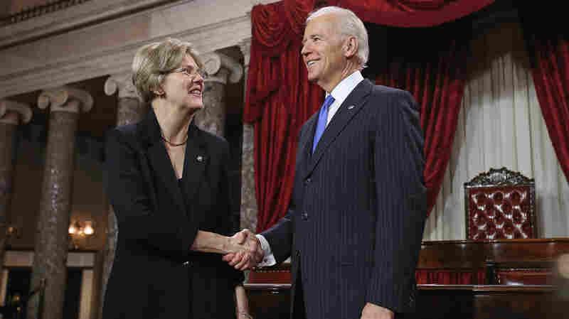 Massachusetts Democratic Sen. Elizabeth Warren and Vice President Biden at a ceremonial re-enactment of Warren's swearing-in on Jan. 3, 2013, in the Old Senate Chamber of the Capitol.