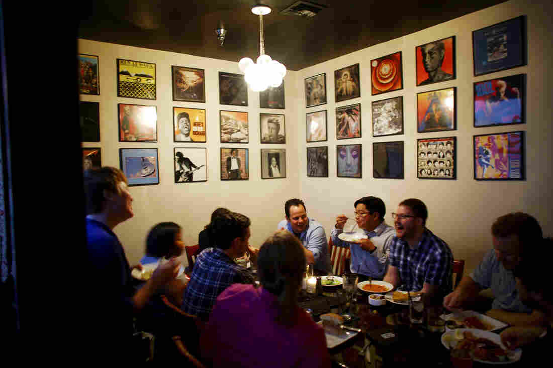"""Computer software designers and engineers gather for a """"hack night"""" at the Capdeville bar and restaurant in New Orleans. The city has a fledgling tech industry."""