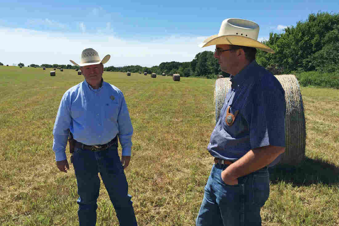 """John Cummings (left) and Bart Perrieron are """"cowboy cops"""" — they're special rangers with the Texas & Southwestern Cattle Raisers Association, which investigates agricultural crimes in Texas and Oklahoma. Cummings says cattle rustling is a crime with """"low risk, high reward, really."""""""