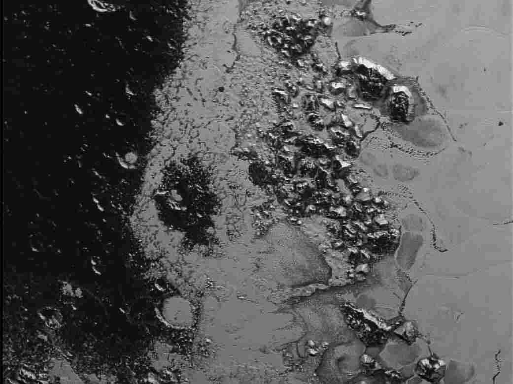 Mountain range near the southwestern margin of Pluto's now-famous heart-shaped Tombaugh Region.