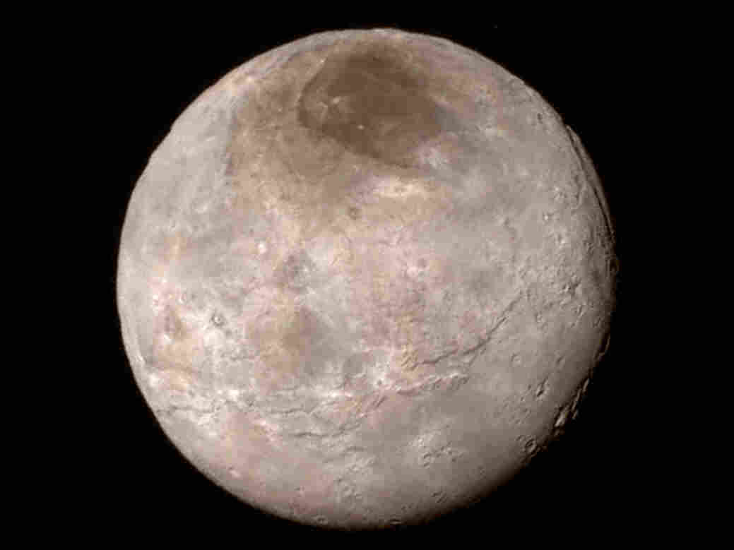 Pluto's largest moon, Charon, revealed from a distance of 289,000 miles.