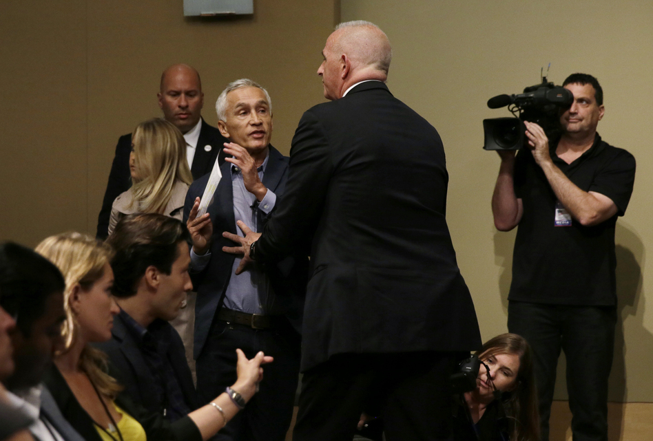A security guard for Republican presidential candidate Donald Trump removes Univision anchor Jorge Ramos from a news conference on Tuesday in Iowa. (Charlie Neibergall/AP)
