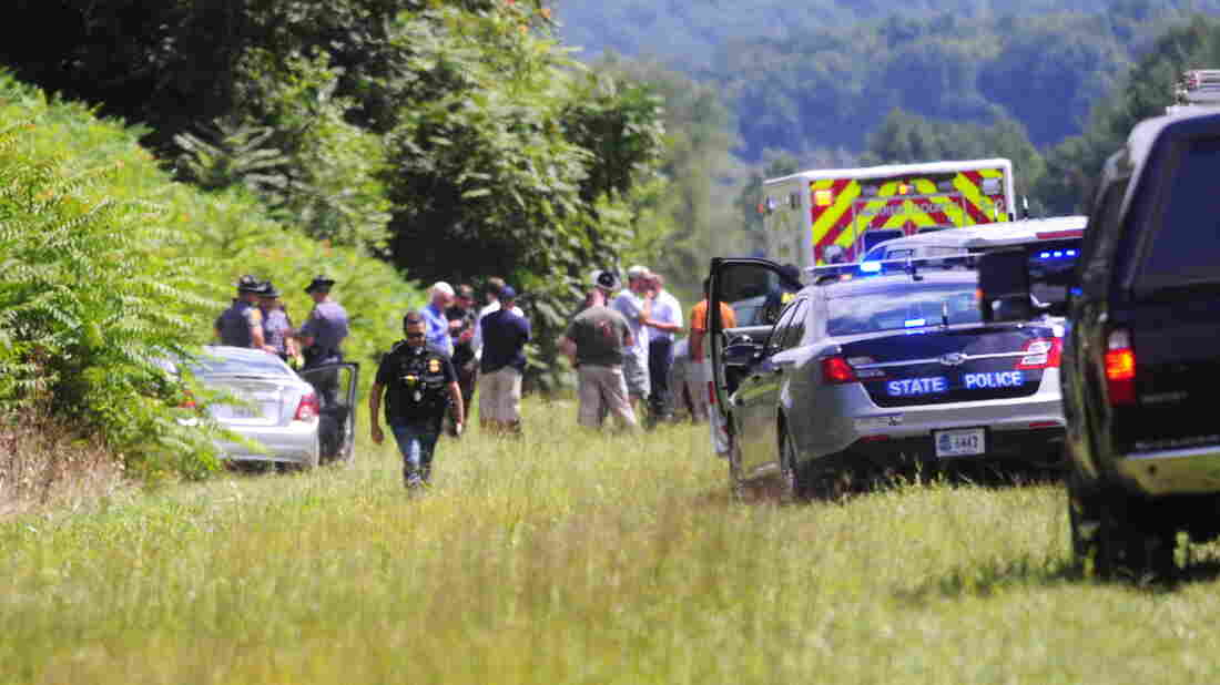A car driven by suspected gunman Vester L. Flanagan, also known as Bryce Williams, is seen off Highway I-66 in Fauquier County, Va., Wednesday. Police say Flanagan killed two people and then shot himself in the car as police closed in on him hours later.