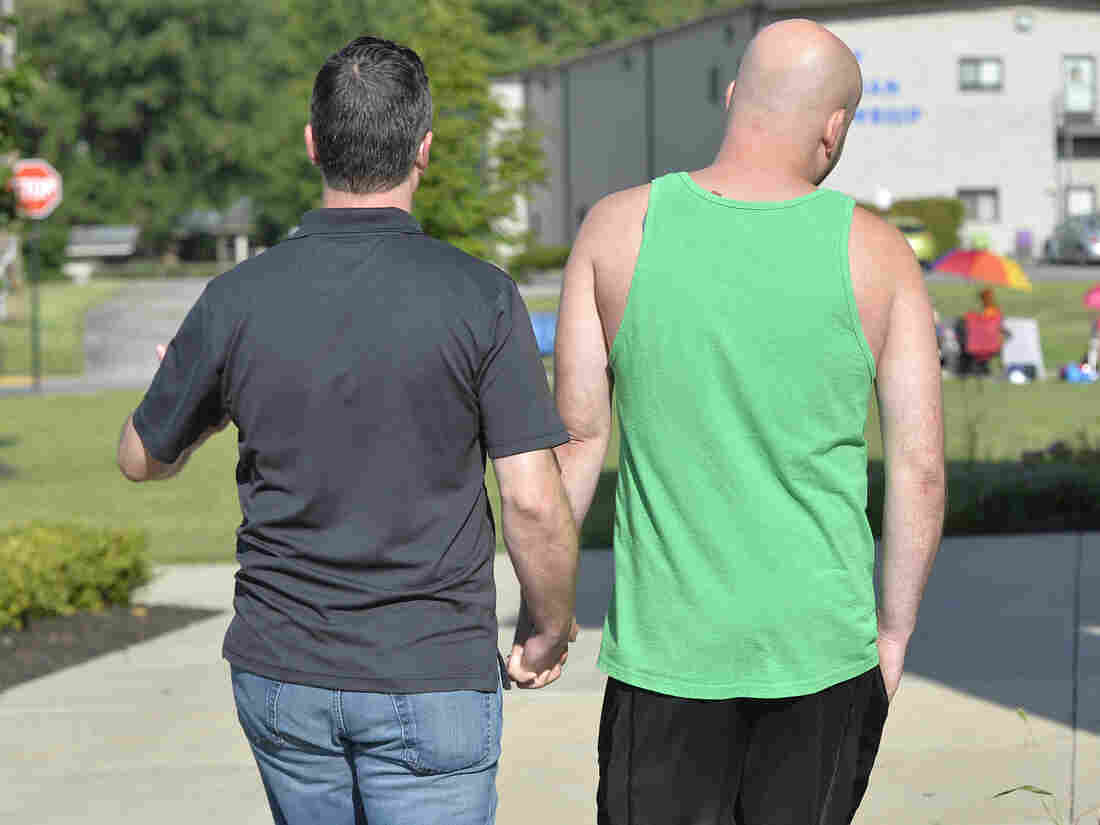 James Yates (left) and William Smith Jr. walk to the Rowan County Courthouse in Morehead, Ky., on Aug. 13 hoping to get a marriage license. They were turned away for a third time Thursday morning.