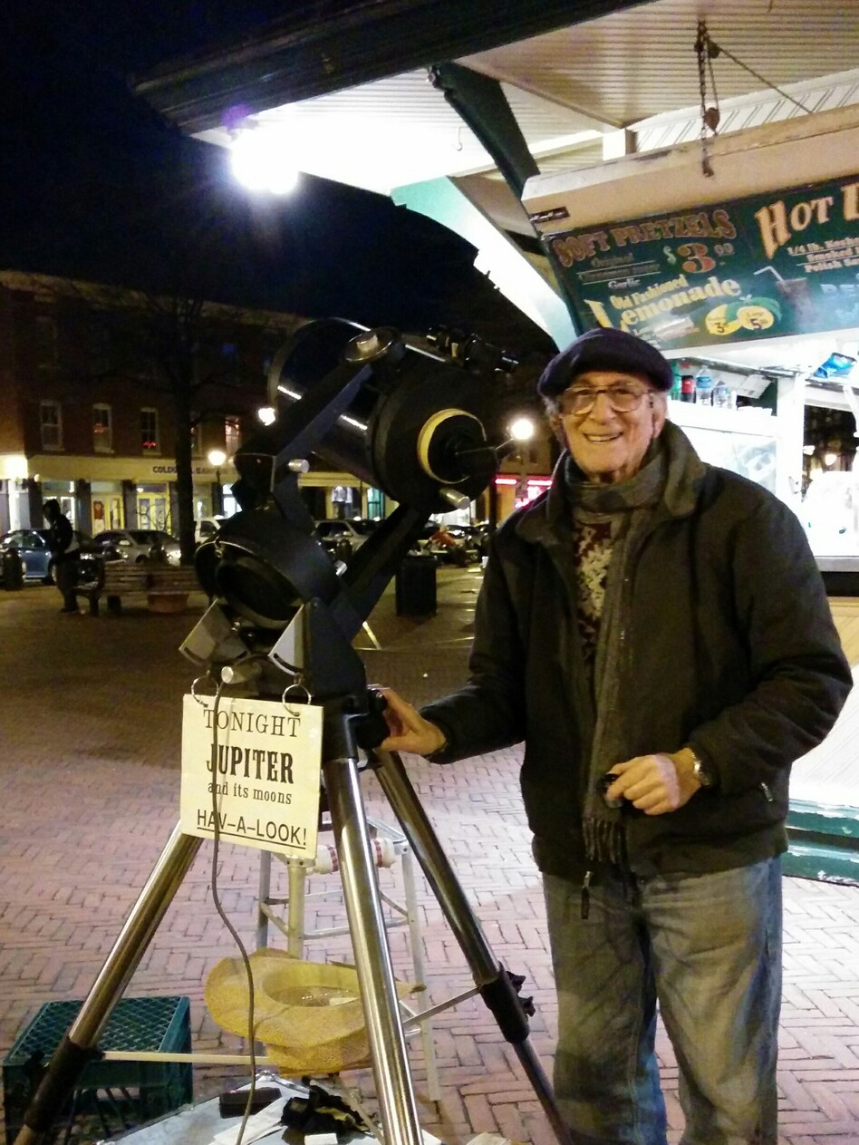 Heyn, in action in Baltimore's Fells Point with that night's feature attraction: Jupiter's moons. (Kevin and Sonia McCarthy/Courtesy of Herman Heyn)