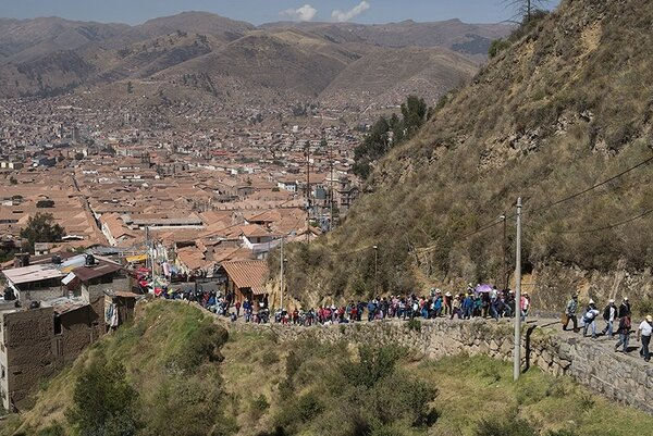 Families walk from the center of Cusco to a temple site at Sacsayhuaman to celebrate Inti Raymi, the Inca Festival of the Sun.