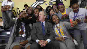 Former President George W. Bush poses for photos with students at Warren Easton Charter High School in New Orleans on Friday. He was visiting the city for the 10th anniversary of Hurricane Katrina.