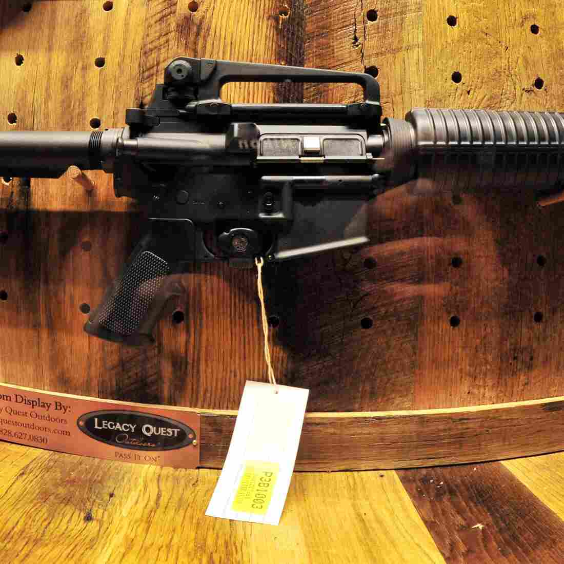 An AR-15 is displayed at a National Rifle Association Convention. This fall, Wal-Mart will end sales of military-style rifles like the AR-15.