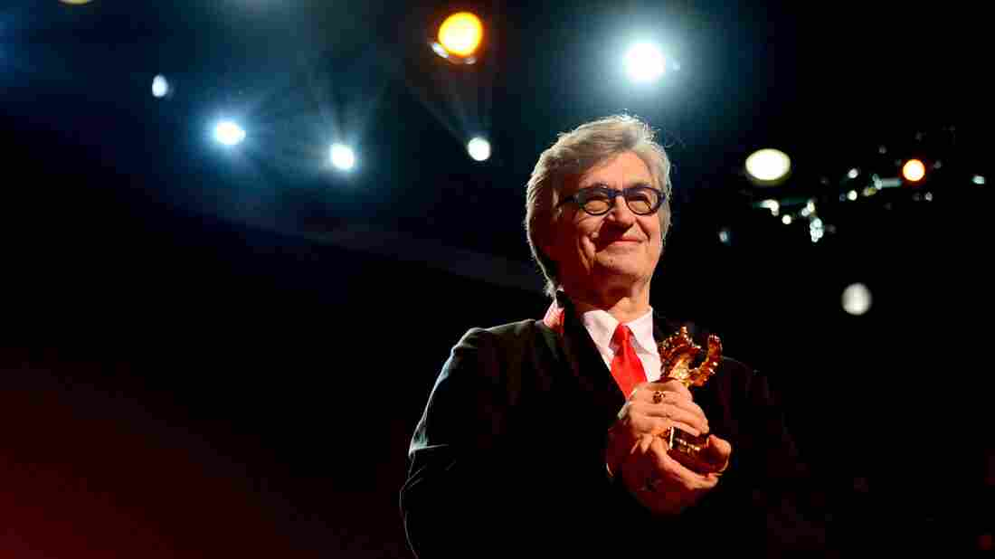 German director Wim Wenders poses with his Honorary Golden Bear Award for lifetime achievement at the Berlin International Film Festival in February.