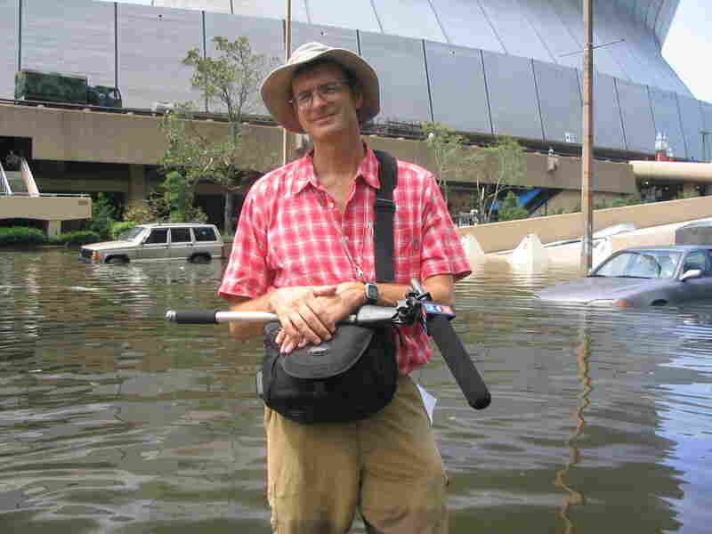 John Burnett, standing in knee-deep water in front of the Superdome shortly after Hurricane Katrina had passed.