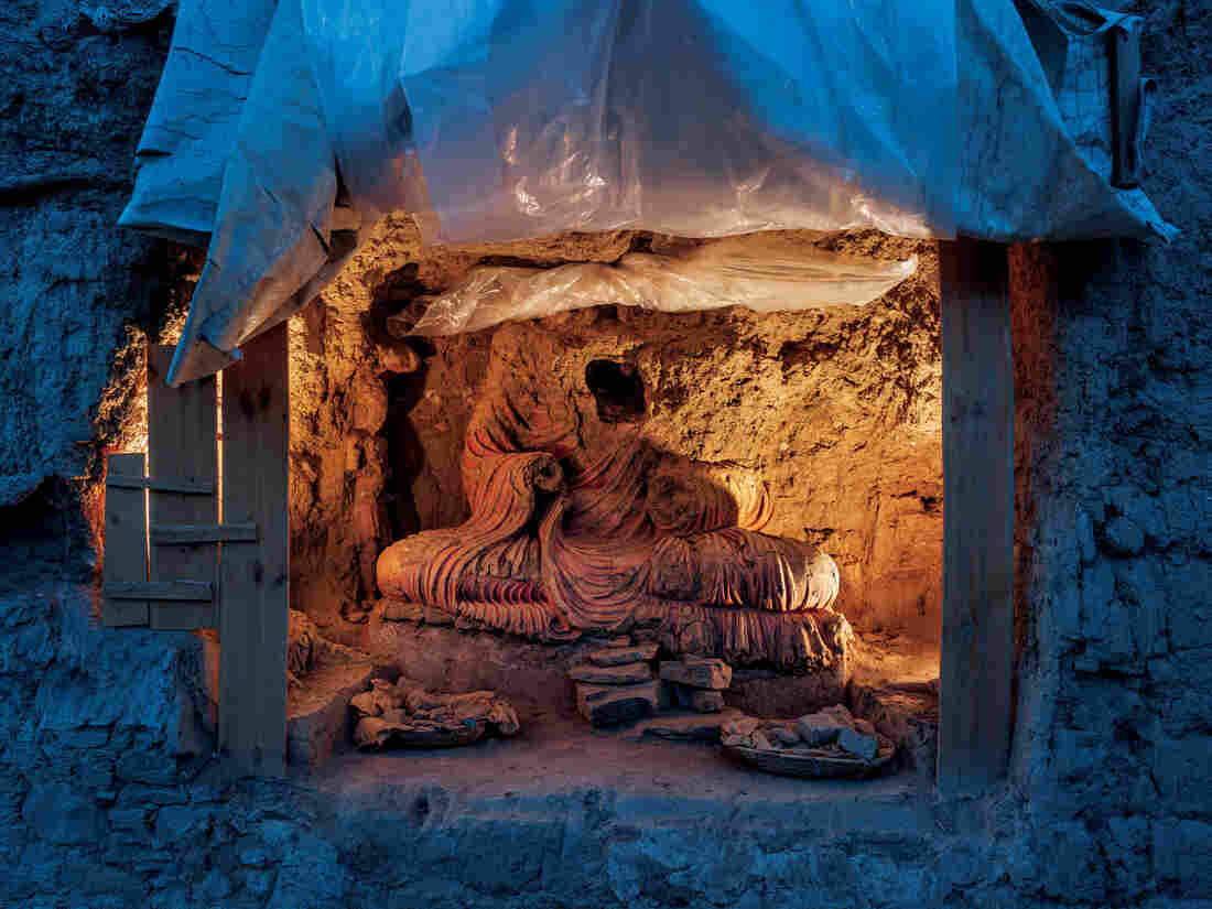 By the time archaeologists uncovered this statue of the Buddha at Mes Aynak, its head was gone — likely broken off by looters.