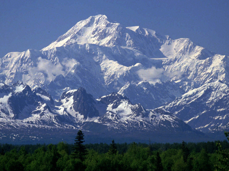 President Obama is renaming Alaska's Mount McKinley in an effort to strengthen cooperation between the government and Alaska Native tribes. The peak is returning to its traditional name, Denali. (Al Grillo/AP)