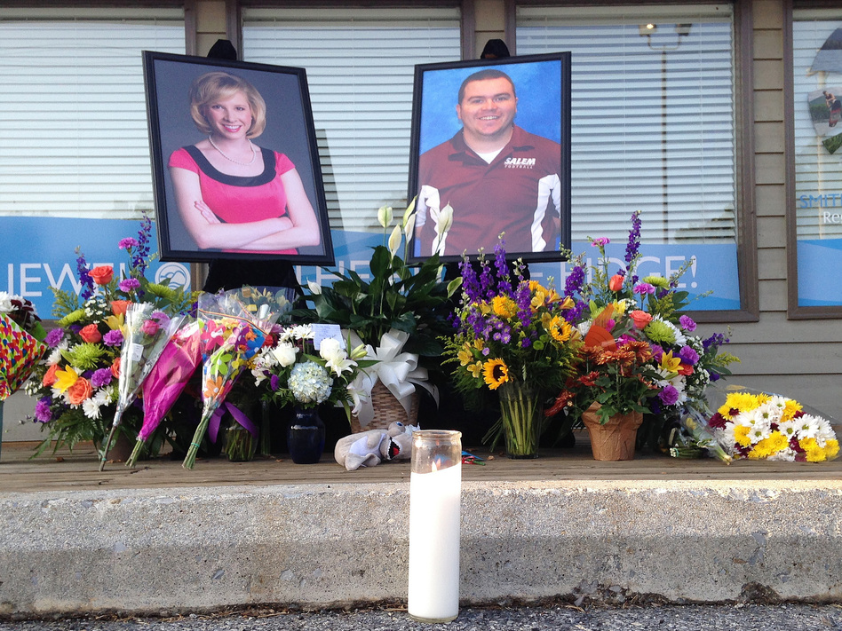 A candle burns in front of a memorial for two slain journalists, Alison Parker and Adam Ward. (Jonathan Drew/AP)