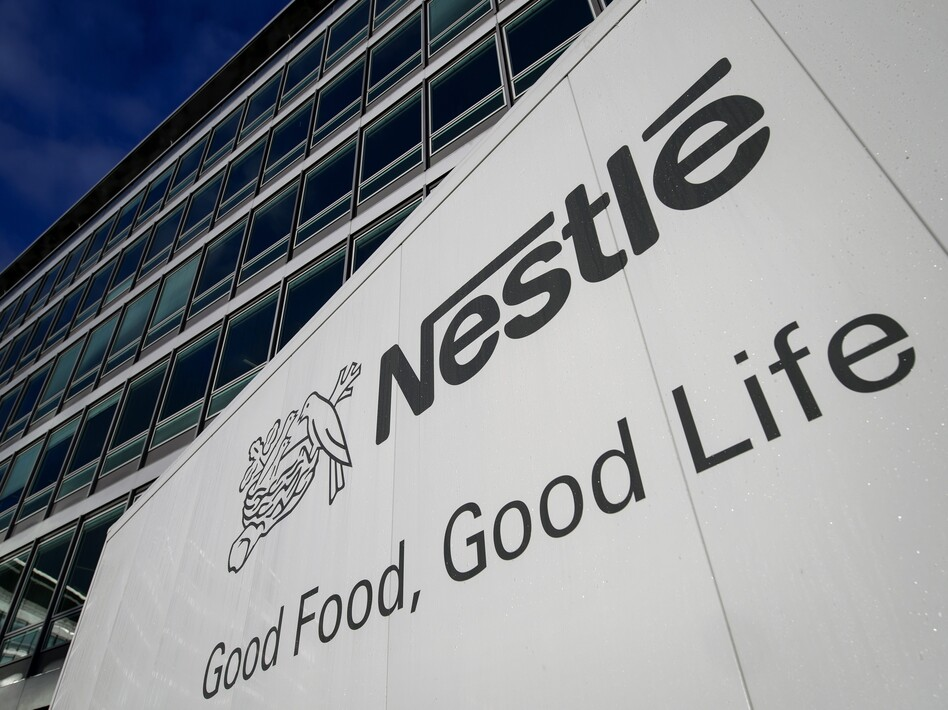 Global food giant Nestle is among several major employers that have announced increases in family leave benefits this year. (Fabrice Coffrini/AFP/Getty Images)