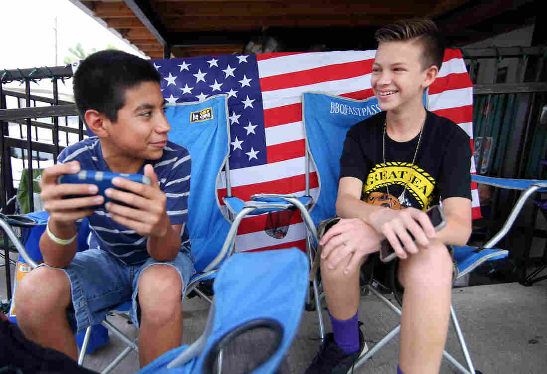 Desmond Roldan (right) is the 13-year-old behind BBQ Fast Pass, the line-sitting service. He's pictured here with his friend, Jiovani Acosta, on July 3, 2015.