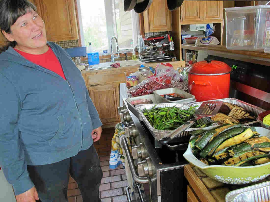 Davidson prepares dinner for 50 in her kitchen in Bethel, Alaska.