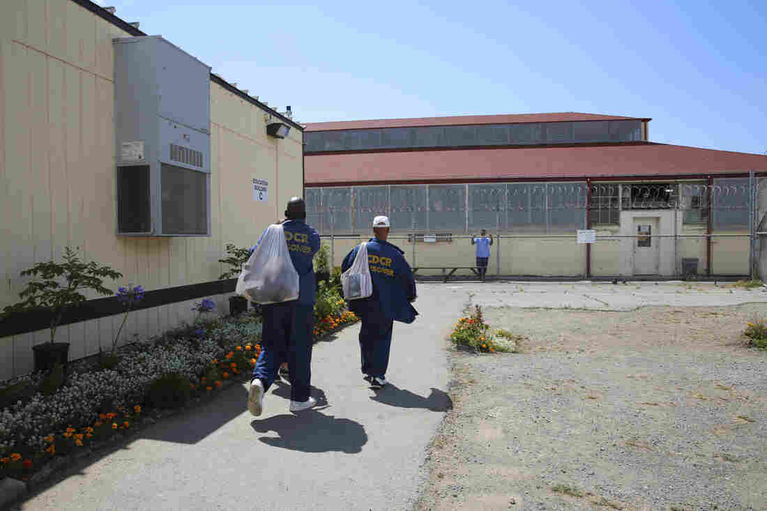 With mesh backpacks slung over their shoulders, inmates walk to school at San Quentin State Prison. Inmates have the chance to earn an associate of arts degree here through the Prison University Project.