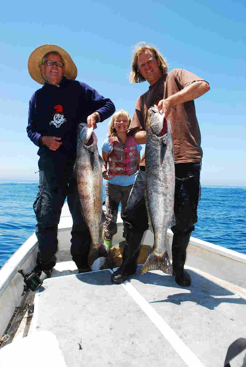Fisherman Eric Hodge (far right) is participating in the pilot Dock to Dish program in California. He's seen here with his father and his daughter Amber, holding white sea bass.