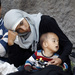 For Second Day, Stranded Migrants Camp Out At Train Station In Budapest