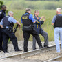 Dragnet Expanded For 3 Suspects In Killing Of Illinois Police Officer