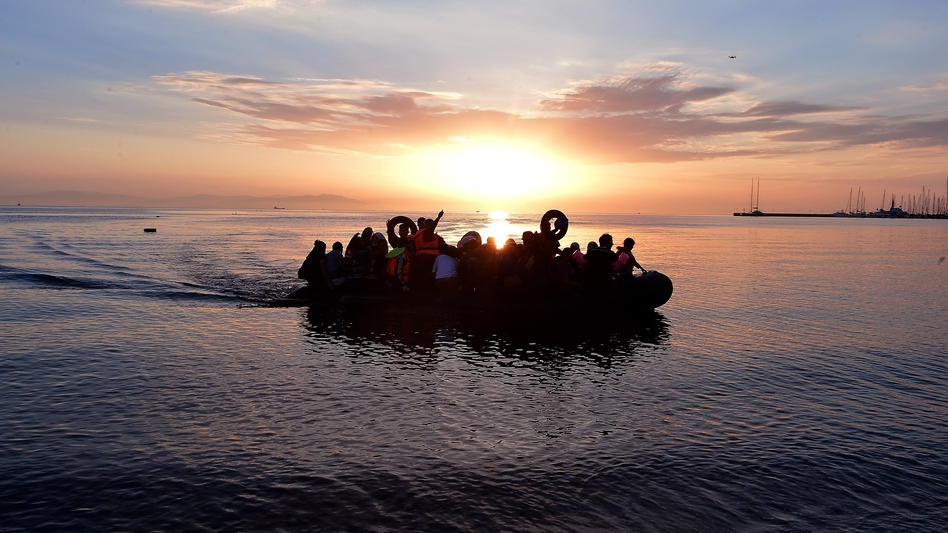 Syrian migrants in an overcrowded dinghy from Turkey arrive on the Greek island of Kos on Aug. 29. (Louisa Gouliamaki/AFP/Getty Images)