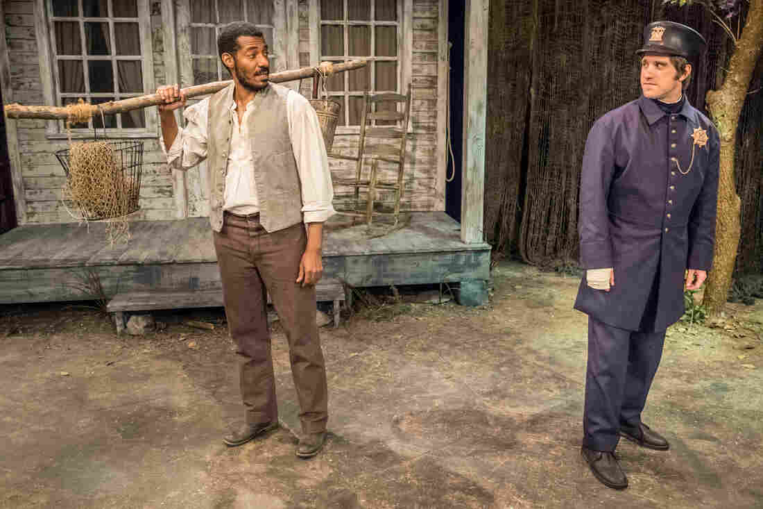 Stephen Van Cleef, a fictional Seneca Village resident played by Billy Eugene Jones (left), meets a New York City police officer, played by Andy Truschinski, in The People Before the Park at Premiere Stages at Kean University in Union, N.J.