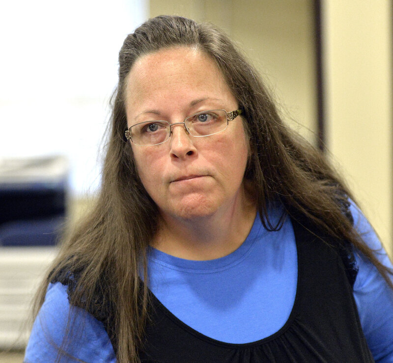Rowan County Clerk Kim Davis listens to a customer following her refusal to issue marriage licenses at the Rowan County Courthouse on Tuesday.
