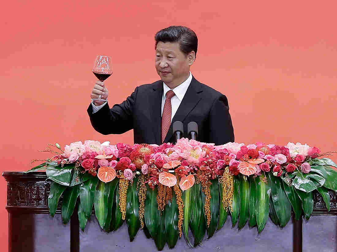 Chinese President Xi Jinping offers a toast in Beijing on Thursday after delivering a speech during a reception to mark the 70th anniversary of Japan's surrender during World War II. Among other things, Xi announced a 300,000 cut in troops.