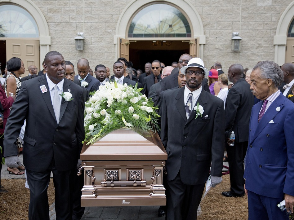 The casket of Ethel Lance is carried to a hearse following her funeral service on June 25. Lance was one of nine people killed in the shooting at Emanuel AME Church in Charleston. (David Goldman/AP)