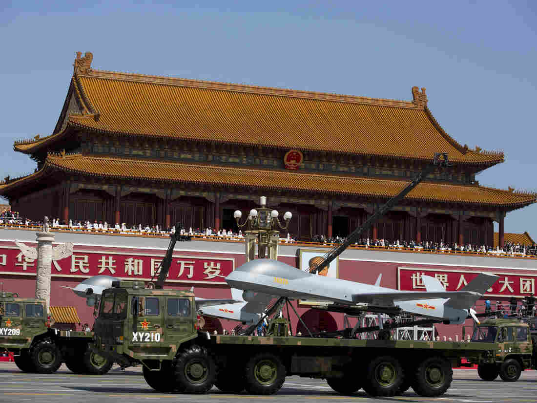 Military vehicles carrying Wing Loong — a Chinese-made, medium-altitude, long-endurance, unmanned aerial vehicle — drive past Tiananmen Gate during a military parade to commemorate the 70th anniversary of Japan's World War II defeat in Beijing on Thursday.