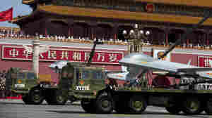 China Flexes Muscles With Parade, But Announces Troop Cut
