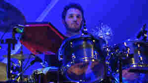Drummer Joey Waronker stares down his own kit during a live performance with the band Atoms For Peace.