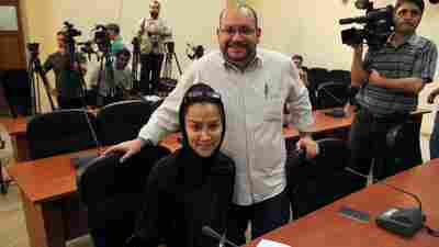 """Washington Post Iranian-American journalist Jason Rezaian, seen here with his wife, Yeganeh Salehi, has been held prisoner since he was arrested in Tehran last July. On Thursday, a powerful Iranian politician said of a potential prisoner swap, """"That's one way."""""""