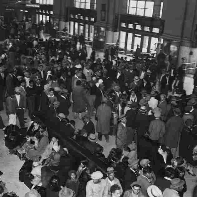 "Mexican and Mexican-American families wait to board Mexico-bound trains in Los Angeles on March 8, 1932. County officials arranged these mass departures as part of ""repatriation campaigns,"" fueled by fears that Mexicans and Mexican-Americans were taking scarce jobs and government assistance during the Great Depression."