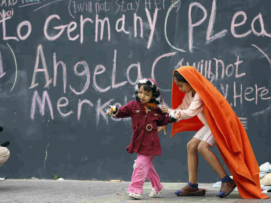 Migrant children play at Keleti railway station in Budapest, Hungary, on Friday. Many of their families hope to reach Germany and gain political asylum.