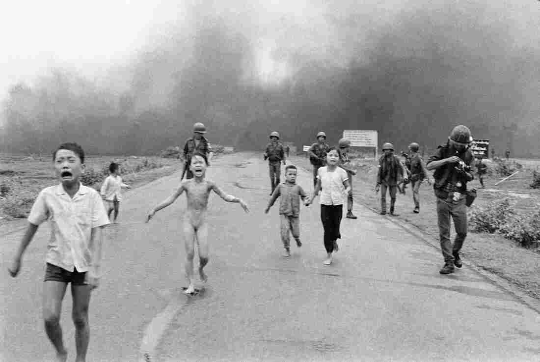 Terrified children, including 9-year-old Kim Phuc (center), flee after a South Vietnamese plane dropped a napalm bomb on June 8, 1972. The girl had ripped off her burning clothes.